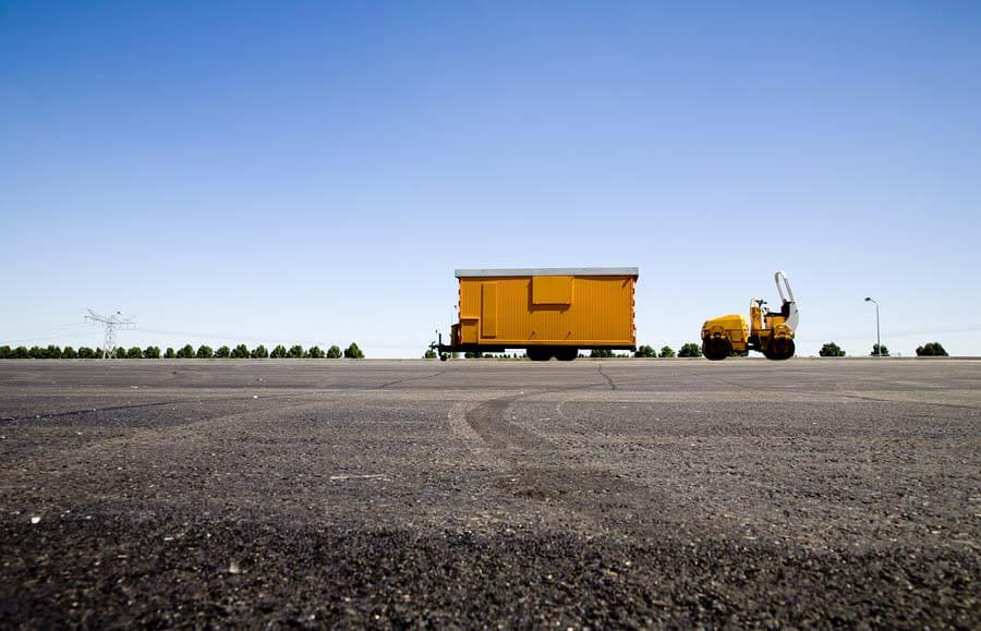 yellow construction trailer